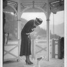 Josephine Baker measuring her weight, standing on weight machine. - 8x10 photo