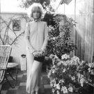 Monica Vitti posing on terrace. - 8x10 photo