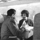 Gina Lollobrigida in airplain with man. - 8x10 photo