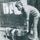Susannah York smiling, with dog and laundry. - 8x10 photo