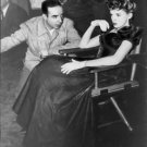 Judy Garland sitting, with Vincente Minnelli. - 8x10 photo