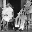Mahatma Gandhi sitting with noble lauret Rabindranath Tagoree. - 8x10 photo