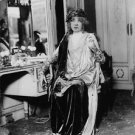 Sarah Bernhardt in one of her costumes, in green room. - 8x10 photo