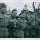 Danish soldiers standing behind the wire fence in Sweden during the war, 1940. -