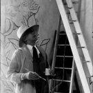 Jean Cocteau holding brush. - 8x10 photo