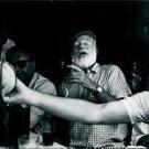 Ernest Hemingway accompanied with friends.  - 8x10 photo