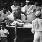 Mahatma Gandhi with some people. - 8x10 photo