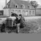 Jean Gabin driving tractor.  - 8x10 photo