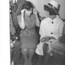 Elizabeth Taylor sitting with lady. - 8x10 photo