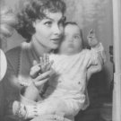 Gina Lollobrigida holding baby. - 8x10 photo