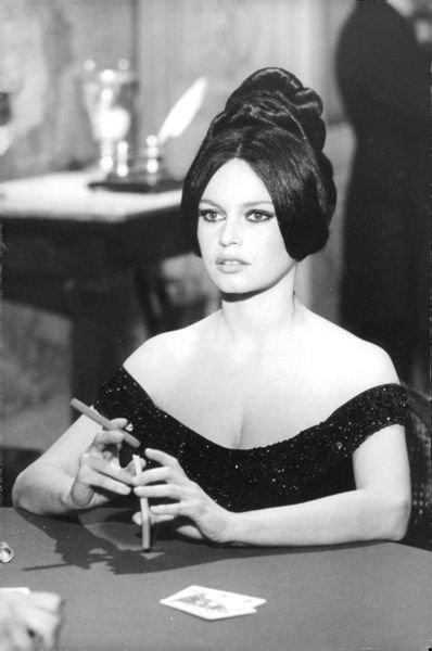 Brigitte Bardot holding cigar.  - 8x10 photo