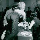 Brigitte Bardot walking on knees on table.  - 8x10 photo