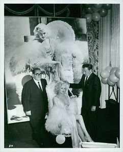 Carroll Baker as Jean Harlow, sitting with men, 1964. - 8x10 photo