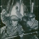 Japan-China War 1937Japanese soldiers throwing grenades into the Chinese trench