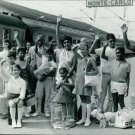 Josephine Baker standing on train station in Monte Carlo with her twelve adopted