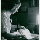 A Wren in dark room developing a photo, England, 1942. - 8x10 photo