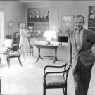 Fred and Ava Astaire standing in a living room. - 8x10 photo