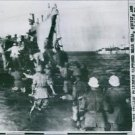 1701 Italian prisoners captured near Gela, Sicily, are loaded onto an Allied Lan