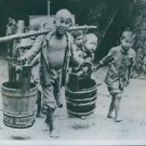Okinawa children help bring water for wounded.The Battle of Okinawa, Operati