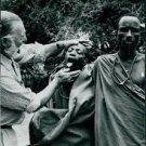 Ernest Hemingway checking tongue of tribal man. - 8x10 photo