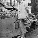 Henri Vidal holding bags. - 8x10 photo