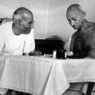 Mahatma Gandhi talking with C Rajgopalcharia. - 8x10 photo