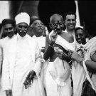 Mahatma Gandhi walking with some people. - 8x10 photo