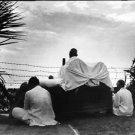 Mahatma Gandhi praying with two man - 8x10 photo