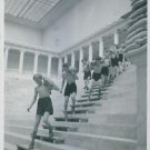 Young men carrying bags going down the stairs.1939 - 8x10 photo