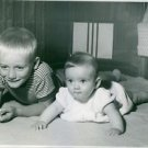 Two Adorable children lying.  - 8x10 photo