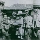Okinawa civilians receive U.S. shoes. - 8x10 photo