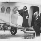 Josephine Baker standing on the entrance of Airplane,posing for camera. - 8x10 p