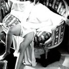Anna Moffo sitting in sofa. - 8x10 photo