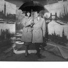 Bernard Buffet holding an umbrella. - 8x10 photo