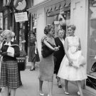 Kim Novak walking on street with women. - 8x10 photo