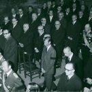 Men standing during prayer. - 8x10 photo