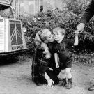 Catherine Deneuve kissing child. - 8x10 photo