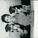 Gina Lollobrigida with puppies - 8x10 photo