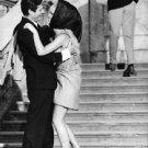 Brigitte Bardot embracing with man. - 8x10 photo