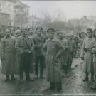 Soldiers gathered in the street while standing during WWI, 1918. - 8x10 photo