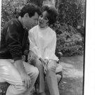 Elizabeth Taylor talking to man in garden.  - 8x10 photo