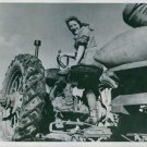 Miss Grace Harrison sitting at her tractor in the farm.  - 8x10 photo