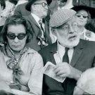 Ernest Hemingway sitting with lady. - 8x10 photo