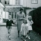 A woman with three children of a royal family, in Luxembourg. - 8x10 photo