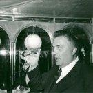 Federico Fellini raising a toast. - 8x10 photo