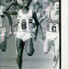 "Philip ""Phil"" Andrew Brown running on ground.  - 8x10 photo"