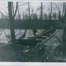 Ninth U.S. Army infantrymen under enemy fire rapidly cross a pontoon footbridge