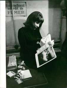 Juliette Greco writing in book.  - 8x10 photo