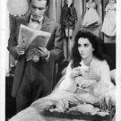 Elizabeth Taylor sitting on bed. - 8x10 photo