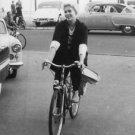 Kim Novak riding a bicycle. - 8x10 photo